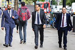 PC Avi Maharaj, 44, left, arrives at Westminster Magistrates Court for sentencing after pleading guilty to one count of fraud relating to use of a member of the public's cable television account to purchase porn as he guarded the body of a deceased teenager , awaiting the arrival of undertakers. London, August 06 2019.