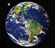 The earth from space. A satellite view of the Americas, including the Atlantic and Pacific coastlines, The Moon is seen (top left).