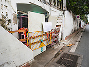 03 SEPTEMBER 2016 - BANGKOK, THAILAND: A blockaded entrance to Pom Mahakan Fort. The map next to the barricade indicates which houses were supposed to be torn down. Hundreds of people from the Pom Mahakan community and other communities in Bangkok barricaded themselves in the Pom Mahakan Fort to prevent Bangkok officials from tearing down the homes in the community Saturday. The city had issued eviction notices and said they would reclaim the land in the historic fort from the community. People prevented the city workers from getting into the fort. After negotiations with community leaders, Bangkok officials were allowed to tear down 12 homes that had either been abandoned or whose owners had agreed to move. The remaining 44 families who live in the fort have vowed to stay.      PHOTO BY JACK KURTZ