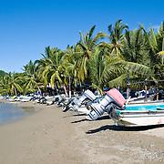 Fishing boats on the beach at Playa Principal at Zihuatanejo, Mexico