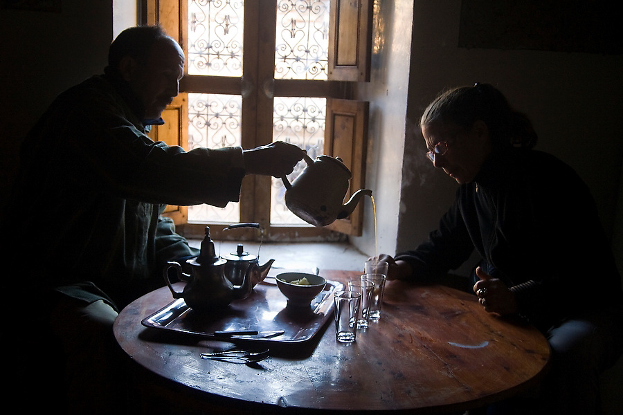 Berber mountain guide Mohamed El Mady serves mint tea to Liana Welty, an American traveler staying at his guesthouse in Ait Alla, M'Goun Massif, Central High Atlas Mountains, Morocco on November 7, 2007.