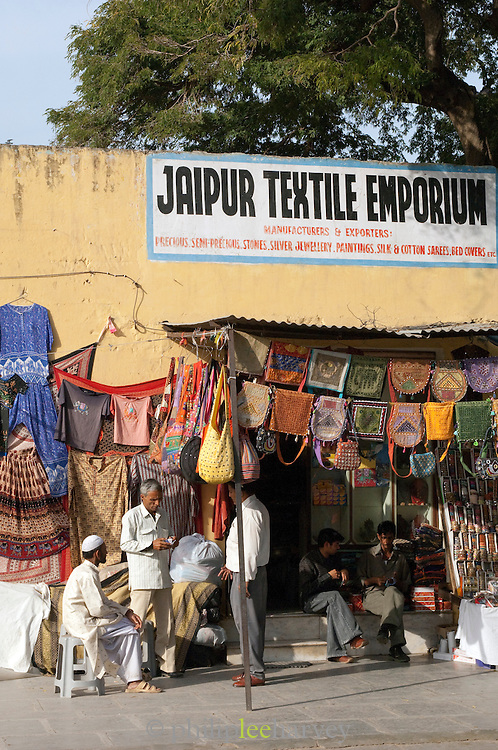 Group of local men sitting at a textiles shop in Jaipur, Rajasthan, India