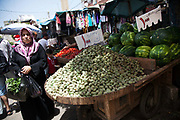 Fruit and vegetable market outside Shatila refugee camp in Beirut. A stall with fresh almonds for sale.