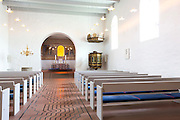 Pews at Jelling Kirke (Gudstjeneste) famous modern architecture church, birthplace of Christianity in Denmark