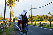 Schoolchildren cycle to school early morning