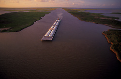 Long barge bringing cargo to the Port of Houston