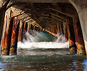 Limited Edition of 17<br /> Pier Pilings East Cape North Island New Zealand. Waves breaking through Pier Pilings in New Zealand