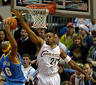 MORNING JOURNAL/DAVID RICHARD<br /> Cleveland's Donyell Marshall, right, goes up to block a slam dunk attempt by Kenyon Martin of Denver last night. Martin was whistled for travelling.