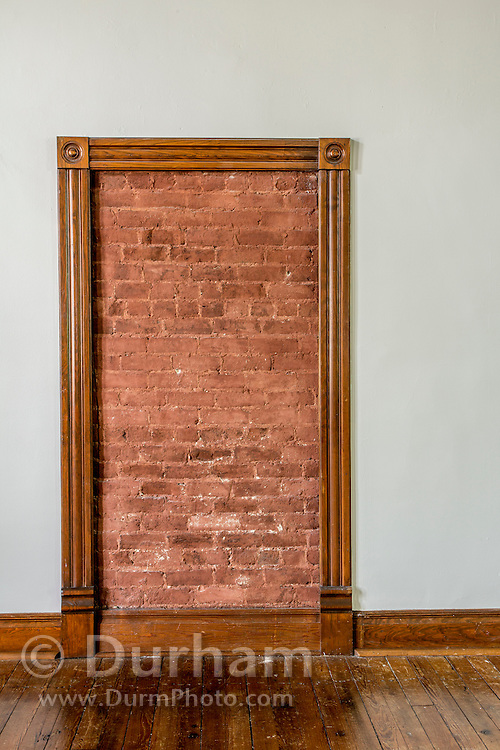 A door blocked by bricks in the still active yet preserved public courtroom in the Rhea County courthouse, in Dayton tennessee where the Scopes trial occured in 1925.. In that year, a high school teacher, John Scopes, was accused of violating Tennessee's Butler Act, which made it unlawful to teach human evolution in any state-funded school. <br /> The trial served its purpose of drawing intense national publicity, as national reporters flocked to Dayton to cover the big-name lawyers who had agreed to represent each side. William Jennings Bryan, three-time presidential candidate for the Democrats, argued for the prosecution, while Clarence Darrow, the famed defense attorney, spoke for Scopes. The trial publicized the Fundamentalist–Modernist Controversy which set modernists, who said evolution was consistent with religion, against fundamentalists who said the word of God as revealed in the Bible took priority over all human knowledge. The case was thus seen as both a theological contest and a trial on whether modern science regarding the creation-evolution controversy should be taught in schools.