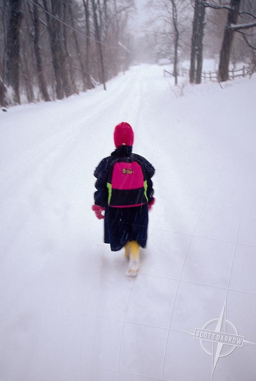 Girl walking to school in snow