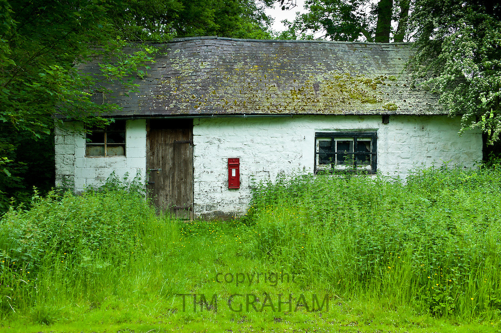 Quaint cottage with wall mounted postbox in Anchor, Shropshire, United Kingdom