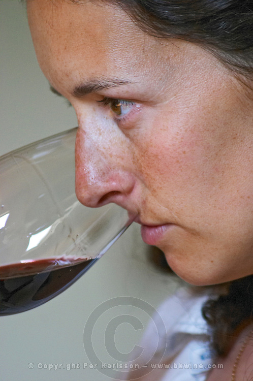 Sylvie Courcelle, daughter to Francis Courcelle, owner and winemaker, tasting a glass of her red wine  Chateau Thieuley La Sauve Majeure  Entre-deux-Mers  Bordeaux Gironde Aquitaine France