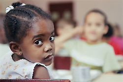 Portrait of nursery school girl looking sad,
