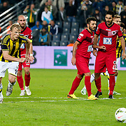 Fenerbahce's Dirk Kuyt (L) scores during their Turkish superleague soccer match Fenerbahce between Genclerbirligi at the Sukru Saracaoglu stadium in Istanbul Turkey on Saturday 25 October 2014. Photo by Aykut AKICI/TURKPIX