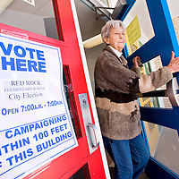 031213       Cable Hoover<br /> <br /> Patricia Hodges leaves after casting her vote for city elections as Sharon Hunt, right, enters the polling station Red Rock Elementary School in Gallup Tuesday.