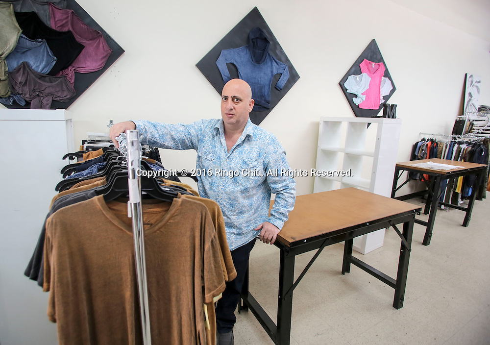 Michael Harb, owner of M. Anthony Inc. in downtown LA, with the desks he's renting out.(Photo by Ringo Chiu/PHOTOFORMULA.com)<br /> <br /> Usage Notes: This content is intended for editorial use only. For other uses, additional clearances may be required.