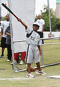 ATLANTA, GA - MAY 14:  A young player calls his home run shot during the Wanna Play clinic at the Civil Rights Youth Summit at Centennial Olympic Park on May 14, 2011 in Atlanta, Georgia.  (Photo by Mike Zarrilli/Getty Images)