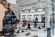 As England finishes its second Coronavirus pandemic lockdown, and London enters a Tier 2 restriction, womens' footwear and accessories are on display in the window of Russell & Bromleys Bond Street shop in the West End, on 2nd December 2020, in London, England.