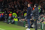Rennes Manager Julien Stephan in the technical area alongside his opposite number Celtic Manager Neil Lennon during the Europa League match between Celtic and Rennes at Celtic Park, Glasgow, Scotland on 28 November 2019.