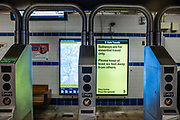 Brooklyn, NY. 5 April 2020. Signs in the entrance to the Avenue J station on the subway's Q line announce service restrictions, and ask that all non-essential riders stay home. This sign comprises a concise decision tree to help people determine whether they should ride or not