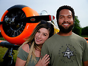 Young couple with North American Aviation Harvard in South African Air Force colors.
