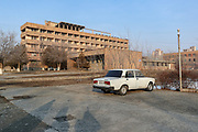 """A general outside view looking at the previously abandoned building of """"SOVIET Hotel"""" in Metsamor on Tuesday, Dec 28, 2020. """"SVOIET Hotel"""" is now filled with internally displaced people from Nagorno Karabakh in Metsamor. According to government statistics, there are 192 000 internally displaced people in Armenia. This figure covers displacement due to a variety of causes. However, according to IOM (International Organisation for Migration) as of Dec 2020 - an estimated 92 639 people alone were displaced as a result of military operations in areas bordering Azerbaijan due to the 44 days of war over the region of Nagorno-Karabakh. (Photo/ Vudi Xhymshiti)"""