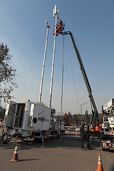 Verizon Wireless crews erect temporary cell towers, in areas of Santa Rosa, California, destroyed by the Tubbs Fire.