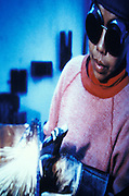 woman welder operating a blow torch