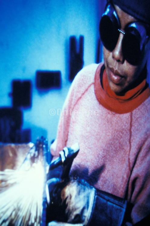 woman welder operating a blow torch