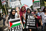 London, UK. Saturday 19th July 2014. Pro-Palestinian protesters in their tens of thousands march through central London to the Israeli Embassy in protest against the military offensive in Gaza by Israel. British citizens and British Palestinians gathered in huge numbers carrying placards and banners calling to 'Free Palestine' and to 'End the seige on Gaza'.