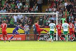 Walsall's Andy Cook scores his side's first goal of the game after seeing his penalty saved by Plymouth Argyle's goalkeeper Matt Macey