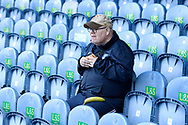 A fan in the stand ahead of the EFL Sky Bet League 1 match between Portsmouth and Ipswich Town at Fratton Park, Portsmouth, England on 21 December 2019.