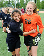 Jackson senior Julie Cervantez and sophomore Paige Asbell congratulate each other after the Lady Broncs shutdown Star Valley during the 3A Wyoming State Soccer Championship on Saturday.