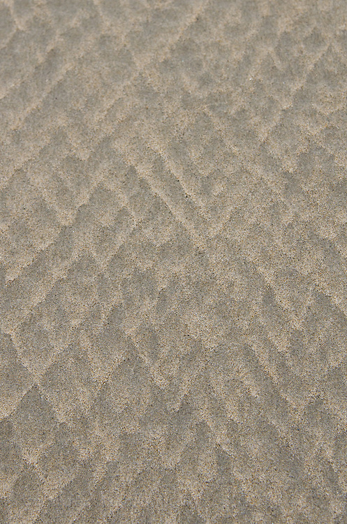 Diamond-shaped patterns in the beach sand, Ogunquit, Maine.