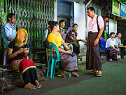 08 NOVEMBER 2015 - YANGON, MYANMAR:   People in central Yangon wait for their polling place to open Sunday. The citizens of Myanmar went to the polls Sunday to vote in the most democratic elections since 1990. The National League for Democracy, (NLD) the party of Aung San Suu Kyi is widely expected to get the most votes in the election, but it is not certain if they will get enough votes to secure an outright victory. The polls opened at 6AM. In Yangon, some voters started lining up at 4AM and lines were reported to long in many polling stations in Myanmar's largest city.      PHOTO BY JACK KURTZ