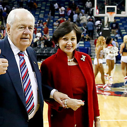 Oct 23, 2013; New Orleans, LA, USA; New Orleans Pelicans owners Tom Benson and Gayle Benson walk off the court following a preseason game against the Miami Heat at New Orleans Arena. The Heat defeated the Pelicans 108-95. Mandatory Credit: Derick E. Hingle-USA TODAY Sports