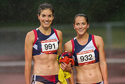 despite the downpours at the Mt Hood Community College track Oiselle teammates Megan Rolland and Mel Lawrence are able to share a smile after racing the 1500
