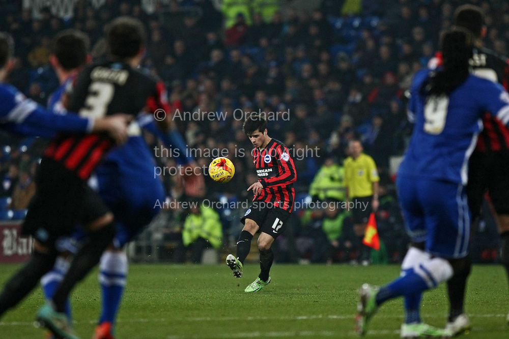 Joao Teixeira of Brighton chips a free kick into a crowded Cardiff penalty area.<br /> Skybet football league championship match, Cardiff City v Brighton & Hove Albion at the Cardiff city Stadium in Cardiff, South Wales on Tuesday 10th Feb 2015.<br /> pic by Mark Hawkins, Andrew Orchard sports photography.