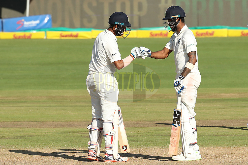 Cheteshwar Pujara of India and K. L. Rahul of India during the fourth day of the second Sunfoil Test match between South Africa and India held at the Supersport park Cricket Ground in Centurion, South Africa on the 16th January 2018<br /> <br /> Photo by: Ron Gaunt / BCCI / SPORTZPICS