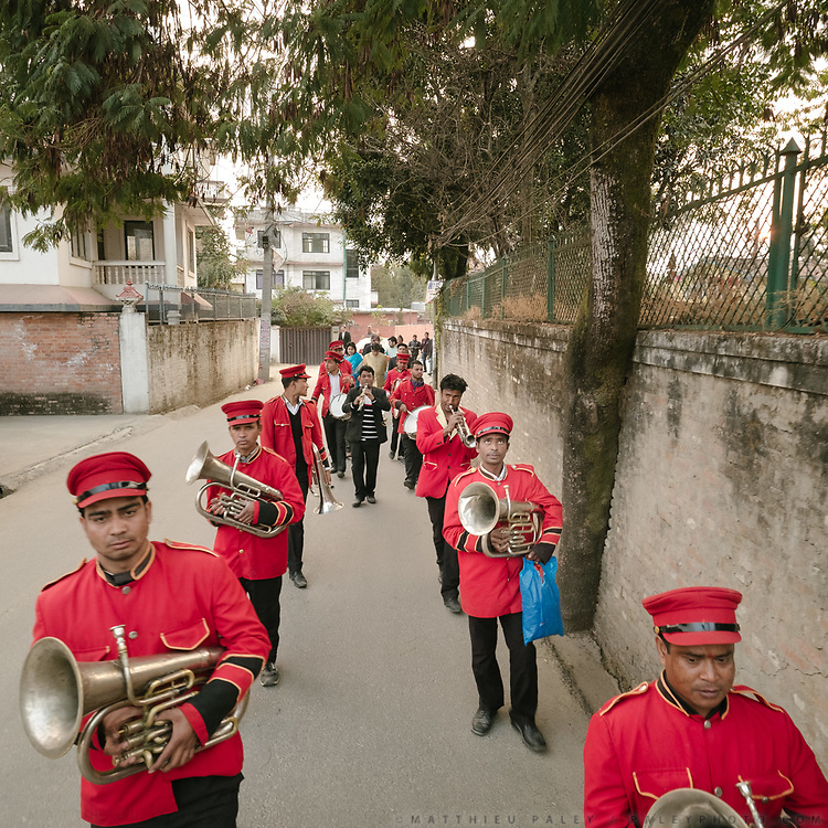 The musicians parade following the weddings in the street.