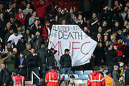 """Manchester United fans hold up a protest flag saying """"Glazers & Edward The Death of MUFC"""" after full time.The Emirates FA cup, 6th round replay match, West Ham Utd v Manchester Utd at the Boleyn Ground, Upton Park  in London on Wednesday 13th April 2016.<br /> pic by John Patrick Fletcher, Andrew Orchard sports photography."""