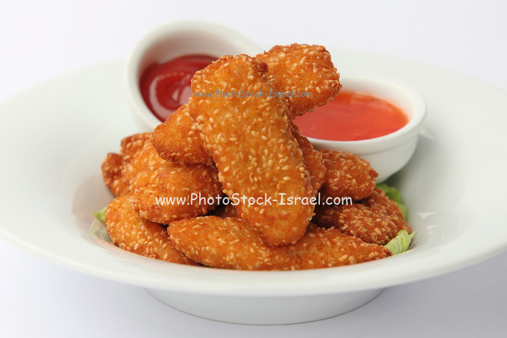 deep fried Sesame seed breaded chicken escalope with sauce dip