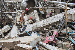 July 4, 2017 - Gazipur, Dhaka, Bangladesh - Rescue workers search for victims in the rubble of the exploded garment factory. At least ten workers have been killed and more than 50 others injured as a boiler of a garment factory of Multifabs Ltd exploded in Gazipur, Bangladesh on Monday evening, 3 July 2017. (Credit Image: © Probal Rashid via ZUMA Wire)