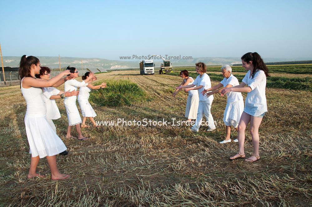 Dancing women celebrating spring harvest. Photographed at Kibbutz Ashdot Yaacov, Israel