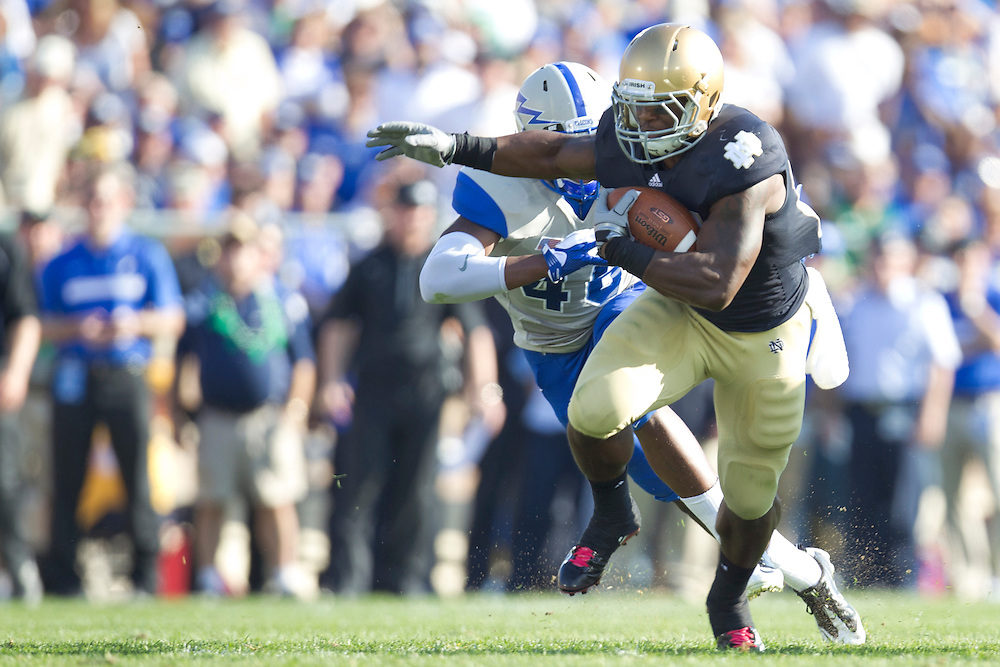 Notre Dame tailback Jonas Gray (#25) runs for yardage in action during NCAA football game between Notre Dame and Air Force.  The Notre Dame Fighting Irish defeated the Air Force Falcons 59-33 in game at Notre Dame Stadium in South Bend, Indiana.