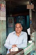 Pavan Jain makes fruit sandwiches at the Jain Coffee House, Old Delhi, India