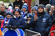 Brighton fans watch on as their team get off the bus on arrival at the Vitality Stadium before the The FA Cup 3rd round match between Bournemouth and Brighton and Hove Albion at the Vitality Stadium, Bournemouth, England on 5 January 2019.