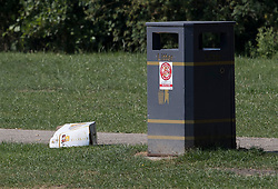 © Licensed to London News Pictures. 06/07/2018. Salisbury, UK. A discarded beer carton is seen next to a rubbish bin in Queen Elizabeth Gardens in Salisbury town centre after couple, named locally as Dawn Sturgess, 44, and her partner Charlie Rowley, 45, were taken ill on Saturday 30th June 2018. Police have confirmed that the couple have been in contact with Novichok nerve agent. Former Russian spy Sergei Skripal and his daughter Yulia were poisoned with Novichok nerve agent in nearby Salisbury in March 2018. Photo credit: Peter Macdiarmid/LNP
