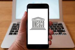 Using iPhone smartphone to display logo of UNESCO
