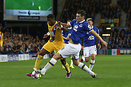 Gareth Barry of Everton (r) tackles Wilfried Zaha of Crystal Palace. Premier league match, Everton v Crystal Palace at Goodison Park in Liverpool, Merseyside on Friday 30th September 2016.<br /> pic by Chris Stading, Andrew Orchard sports photography.